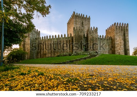 Guimaraes, Portugal - November 23 , 2014 : End of a sunny day in the autumn next to the castle of Guimaraes #709233217