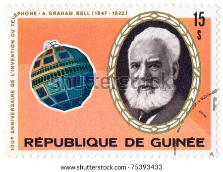 GUINEA - CIRCA 1976: A stamp printed in Guinea shows portrait of Alexander Graham Bell and Telstar satellite, series, circa 1976