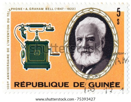 GUINEA - CIRCA 1976: A stamp printed in Guinea shows portrait of Alexander Graham Bell and Wall telephone, 1910, series, circa 1976