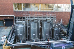 Guinness brewery, Dublin, Ireland - fermentation vessels and tubes of a beer brewery.