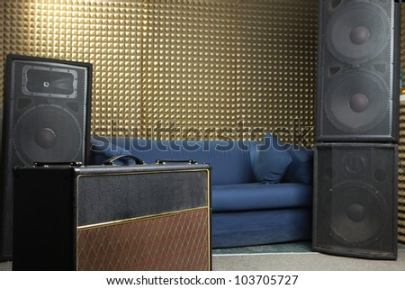 Guitar amplifier and audio system in recording studio.