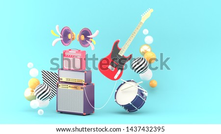 Guitar amplifiers, guitars and drums surrounded by colorful balls on a blue background.-3d rendering.