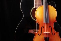 Guitar and violin on black