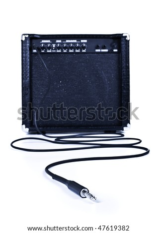 guitar aplifier with cable, focus on plug, white background