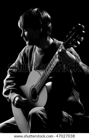 black and white guitar player. stock photo : Guitar concert. Silhouette of guitar player in darkness.