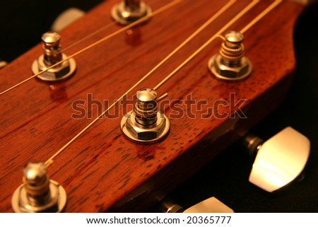 tuning pegs guitar. neck and tuning peg.