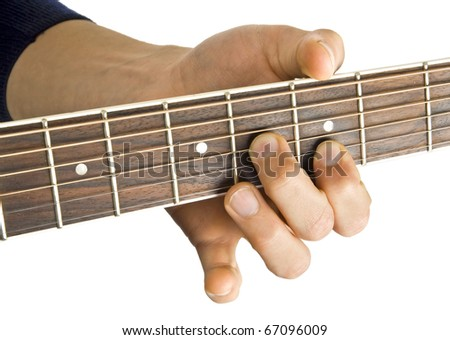 guitar in hands in the guy playing it