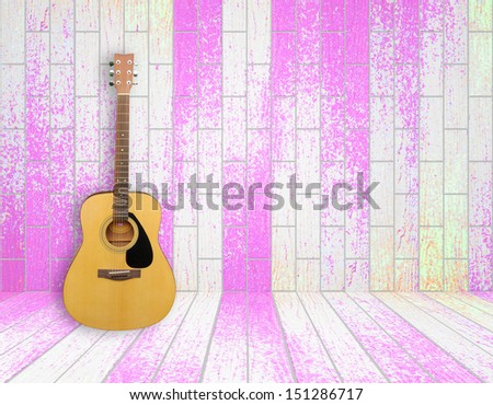 Guitar in old empty wood room background