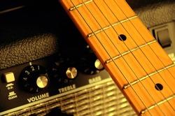 Guitar leaning guitar amp , guitar sepia photographs