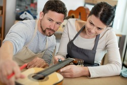 guitar maker and craftsma at work