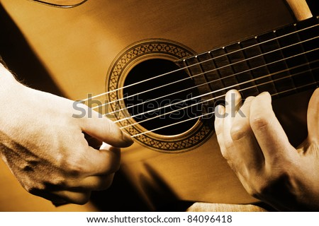 Guitar musical instrument art. String guitarist acoustic playing. Details performer hands vintage retro photo