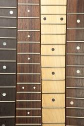 Guitar necks aligned, Rosewood, maple and ebony fingerboard necks