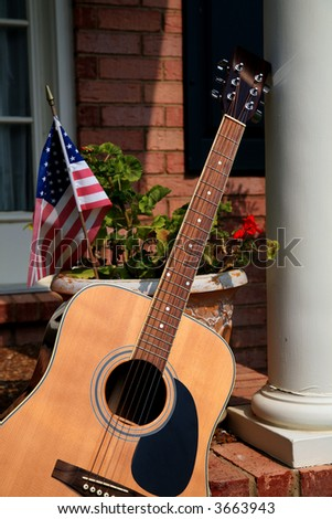 Guitar on a Porch - stock photo