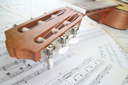 guitar on music sheet , headstock closeup