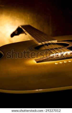 Guitar on the dark background.