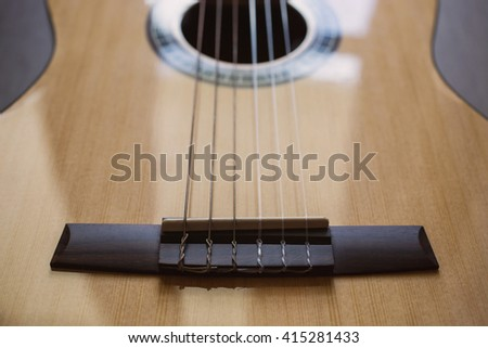 Guitar on wooden background, fretboard, stringed musical instruments, guitar details close up, solo instrument, blues, country, flamenco, rock, metal, jazz    #415281433