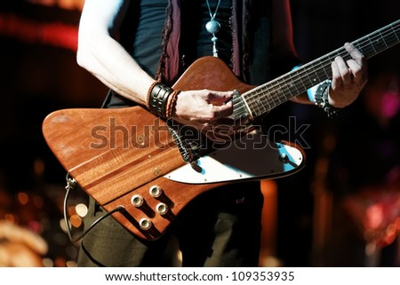 Guitar player in detail