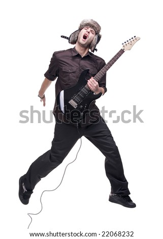 Guitar player jumping in midair isolated against white background