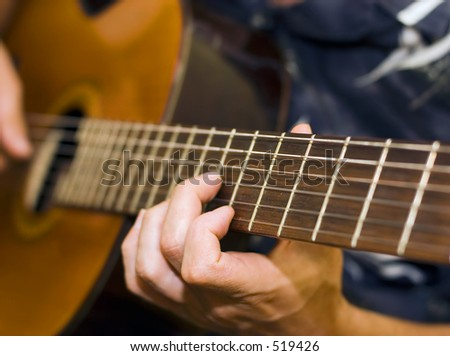 Guitar player (shallow depth of field)