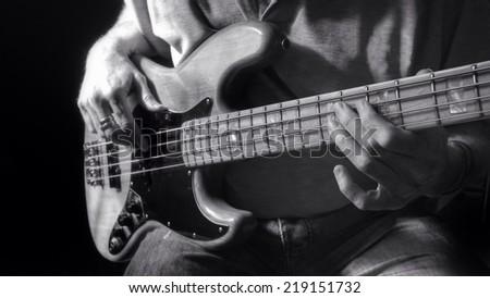 Guitar player using a electric bass guitar.