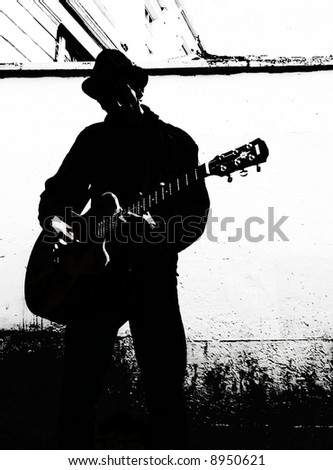black and white guitar player. stock photo : Guitar player without face - black and white.