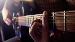 Guitar Playing. Man Playing Acoustic Guitar Closeup