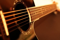 Guitar side view - string, fingerboard. Can be used as a nice background.