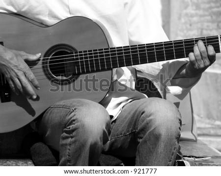 guitar street performer playing in Spain