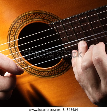 Guitar string music art. Acoustic guitarist playing. Details of musical instrument with performer hands