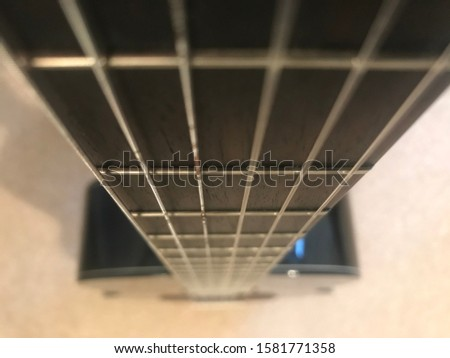 Guitar strings acoustic perspective  close-up
