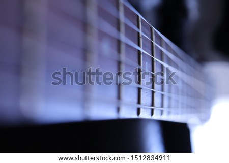 Guitar strings macro closeup. Music instruments background. Musician lifestyle instrument backdrop.