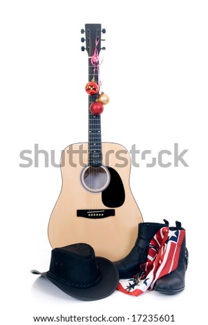 Guitar with cowboy hat and boots, decorated with Christmas-balls, isolated on white background
