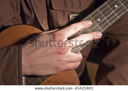 Guitar with hand