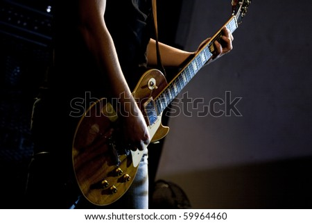 guitarist of a rock band with a guitar