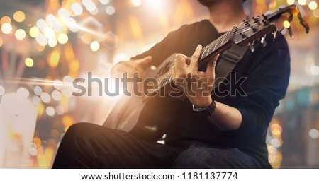 Guitarist on stage and sings at a concert for background, soft and blur concept