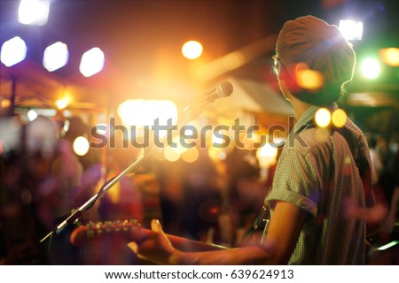 Guitarist on stage for background, soft and blur concept #639624913