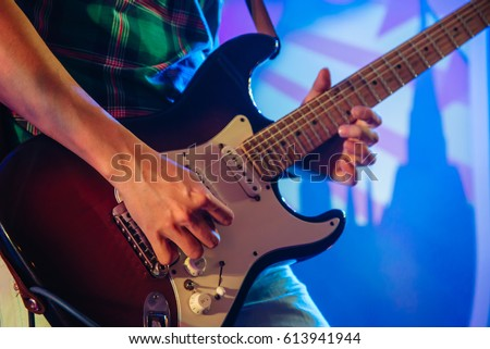 Guitarist on stage for background, soft focus background concept.