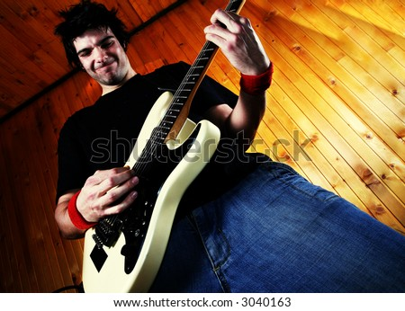 Guitarist play rock guitar. Specific man face expression