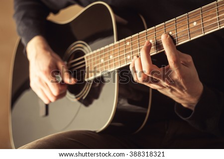 guitarist playing acoustic guitar close-up shot  stock photo