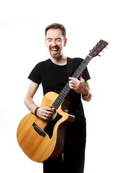 Guitarist playing and singing loudly on isolated a white background