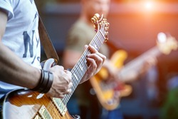 Guitarist playing live concert with rock band.