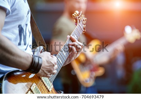 Guitarist playing live concert with rock band. Stock photo ©
