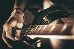 Guitarist Plays. Electric Guitar Playing Closeup Photo. Rockman Guitar Player Music Theme.
