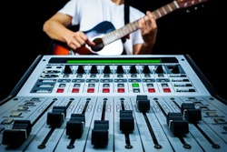 guitarist & recording mixer in studio, isolated on black for music background