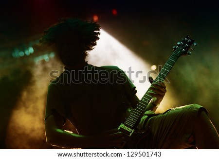 Guitarist silhouette - stock photo
