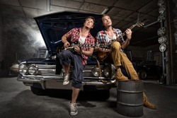 Guitarists at a garage next to the retro car in smoke