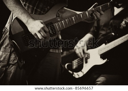 guitarists of a rock band with a guitar