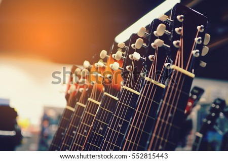 guitars  for sale hanging in a music store. #552815443