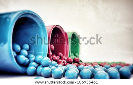 gumballs coming out from dispensers