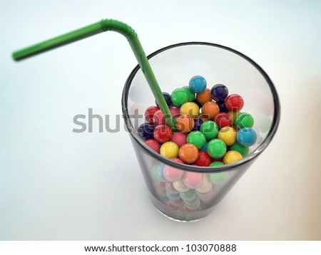 gumballs in a glass isolated on white background
